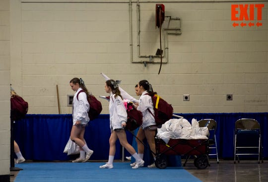 Henderson County cheerleaders exit Rupp Arena after being told the KHSAA Sweet 16 tournament had been suspended to try to stem the spread of the coronavirus in Lexington, Ky., Thursday afternoon, March 12, 2020.