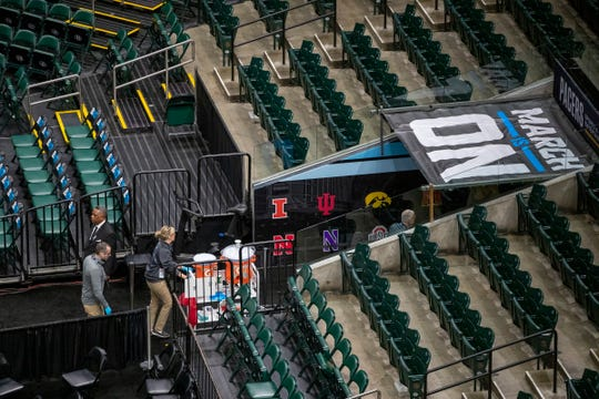Water coolers being taken out of an empty arena, moments after the cancel order was put in to halt the Big Ten Men's Basketball Tournament, Bankers Life Fieldhouse, Indianapolis, Thursday, March 12, 2020. Fears over the virus that causes COVID-19 prompted the decision.