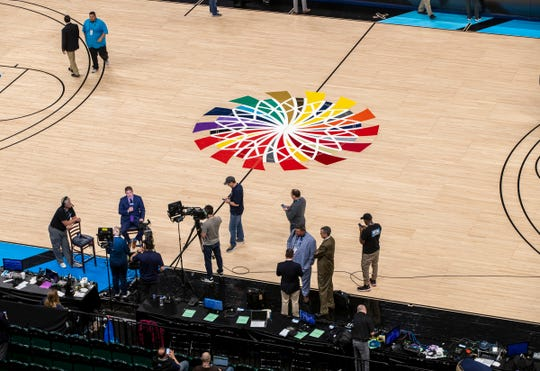 Media members work on their broadcasts in an empty arena, moments after the cancel order was put in to halt the Big Ten Men's Basketball Tournament, Bankers Life Fieldhouse, Indianapolis, Thursday, March 12, 2020. Fears over the virus that causes COVID-19 prompted the decision.