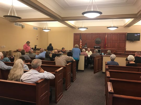 Community members and Decatur County commissioners gather in the Decatur County Courthouse in Decaturville, Tenn. on March 10, 2020 as the Decatur County Hospital Board voted to decide the hospital's fate.