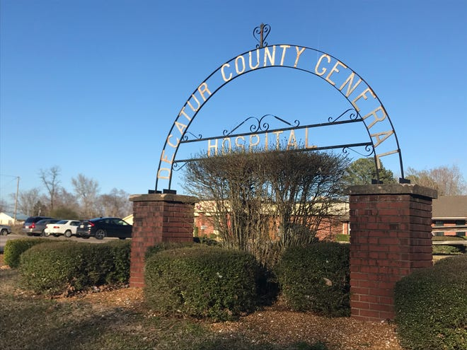 A Decatur County General Hospital sign gifted by Parsons High School Class of 1963 stands in front of the Parsons, Tenn., hospital, which is on the brink of closure.