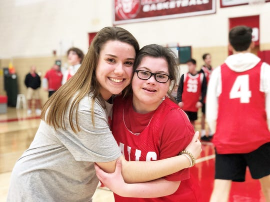 Kennedi Holbert, left, is the vice president of the S.A.C.C. Club and helped organize the Tuesday Night Lights game. Pictured here with her sister, Morgan Holbert, who scored the first point of the game. March 10, 2020, at Halls High School.