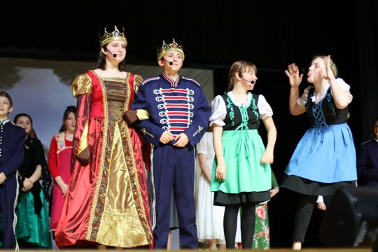 """Marisol Gonzalez as Queen Iduna, Jacob Braden as King Agnaar, Cydney Scott as Young Anna and Charity Davis as Young Elsa in """"Disney Frozen Jr."""" at South-Doyle Middle School on March 7, 2020."""