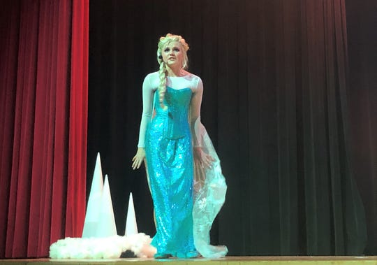 """Elsa, played by Ferryn Wright, brings the house down during her performance of """"Let it Go"""" in """"Disney Frozen Jr."""" at South-Doyle Middle School on March 7, 2020."""