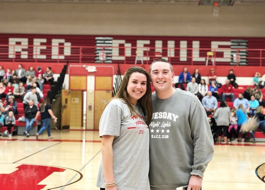 Kennedi Holbert, left, is the vice president of the S.A.C.C. Club and helped organize the Tuesday Night Lights game with club president Austin Angel. March 10, 2020 at Halls High School.