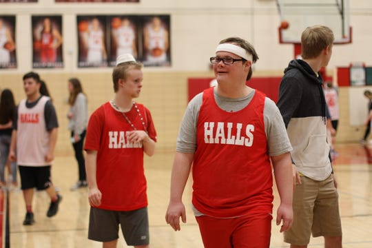 Alex Webb and Maddox Shields hang out with other student athletes during halftime at the Halls High Tuesday Night Lights game on March 10, 2020.