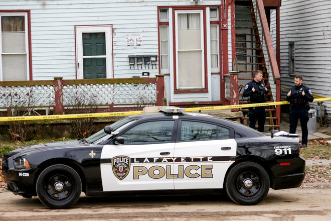 Two Lafayette Police officers stand outside a crime scene during a homicide investigation, Friday, Dec. 13, 2019 in Lafayette.