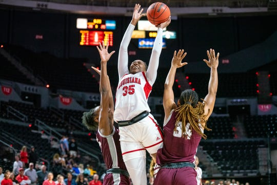 """UL's Ty'Reona """"Ty"""" Doucet takes the ball to the basket in a win over Little Rock last month at the Cajundome."""