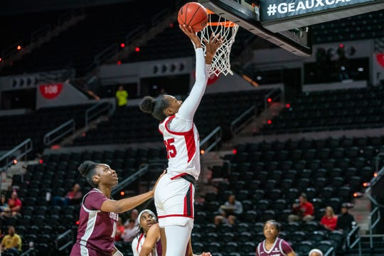 UL's Ty'Reona Doucet leaps up to the goal to score as the Ragin' Cajuns beat the Little Rock Trojans 49-46 at the Cajundome on Wednesday, March 11, 2020.