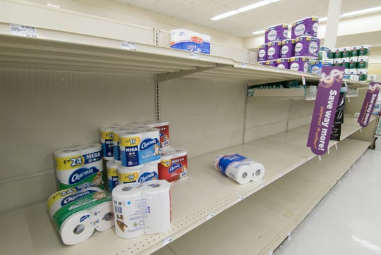 Stocks of toilet paper in the Howell VG's grocery store, shown Thursday, March 12, 2020, are sparse.