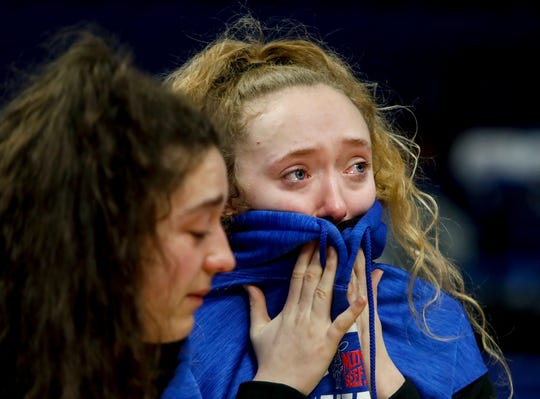 Russell Independent's Malia Blevins, left, and Kate Ruggles cry after learning the 2020 KHSAA Girls' Sweet 16 State Basketball Tournament was postponed on Thursday.
