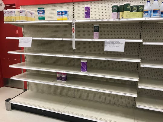 Shelves where disinfecting wipes once sat are nearly empty at a Target store in Lansing on March 12, 2020. Shoppers are stocking up on cleaning supplies as COVID-19 sweeps the nation.