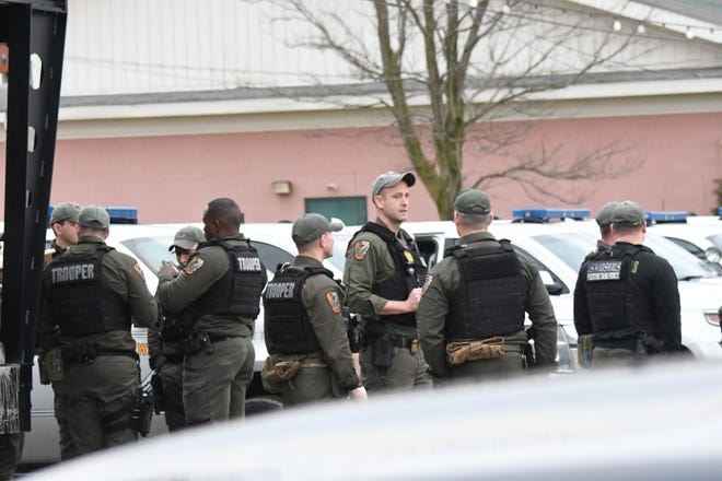Law enforcement stage at the Richland County Fairgrounds on Thursday morning.