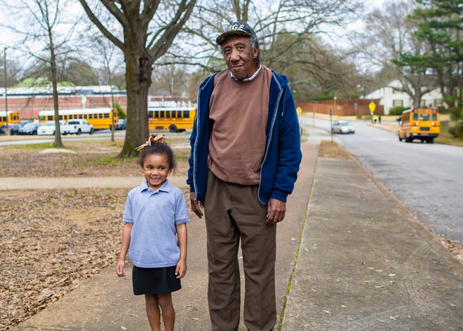 William Moore picks up his granddaughter, Kaliyah Johnson, from White Station Elementary School on Thursday, March 12, 2020.