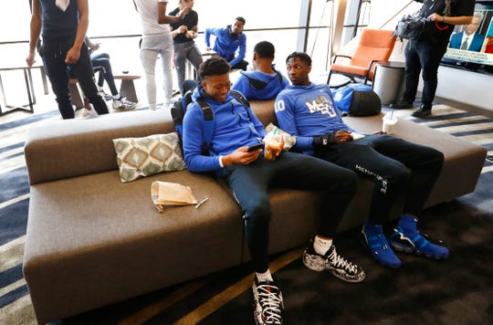 Memphis Tigers basketball players Boogie Ellis, left, and Damion Baugh sit with their teammates as they prepare to leave their hotel in Fort Worth, Texas after AAC officials officially cancelled their conference tournament basketball games following concerns of the COVID-19 pandemic on Thursday, March 12, 2020.