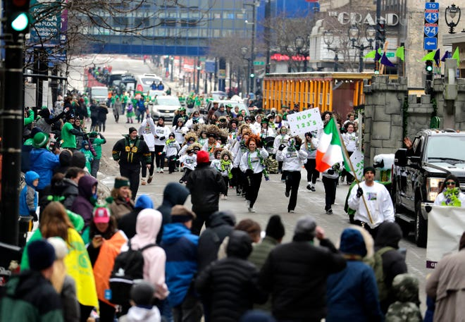 """The Glencastle Irish Dancers engage the crowd during the Shamrock Club of Wisconsin's 53rd annual St. Patrick's Day Parade in downtown Milwaukee on March 9, 2019. The 2021 downtown St. Patrick's Day parade has been canceled, but organizers are hoping to stage a """"halfway to St. Patrick's Day"""" parade in September."""