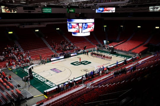 The stands are mostly empty during the singing of the national anthem before Arcadia High School plays against Platteville High School during their Division 3 semifinal game at the WIAA girls state basketball tournament Thursday at the Resch Center in Ashwaubenon.