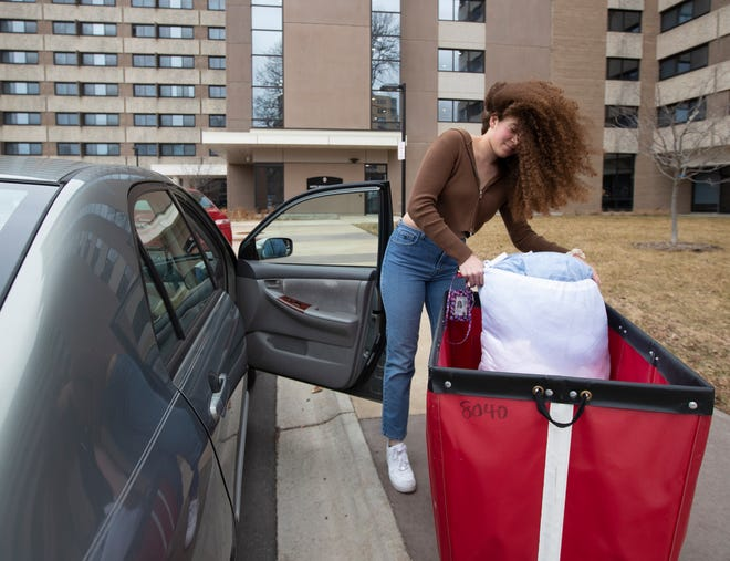 A student moves out of Witte Residence Hall on the campus of UW-Madison on Thursday. The university is one of multiple Wisconsin universities that took dramatic steps to ward off or curb the spread of the COVID-19 outbreak, everything from moving courses online to canceling university-sponsored travel and events to extending spring break.