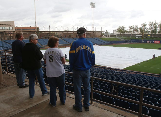 Fans look over American Family Fields of Phoenix, the site of Brewers spring training Thursday. Major League Baseball has elected to cease spring-training games and delay the start of of the regular season by at least two weeks.