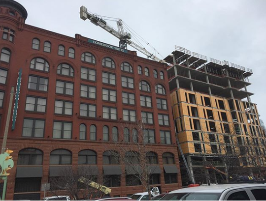 The Huron Building is under construction at 511 N. Broadway, east of downtown's Homewood Suites Hotel on March 12, 2020. Tupelo Honey Southern Kitchen & Bar will open on its ground floor.