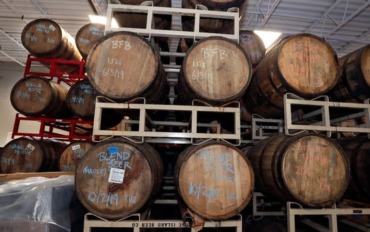 Barrels are stacked high at Mikerphone Brewing in Elk Grove, Ill. Founder Mike Pallen, a Mukwonago native, collaborates with several Milwaukee breweries.