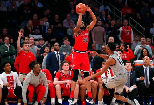 St. John's and Georgetown played their Big East tournament game with a crowd Wednesday night, but only a few people will be let into games beginning Thursday.