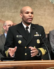 United State Surgeon General Jerome Adams said Louisiana and America are 'at an inflection point' in the new coronavirus crisis during a press conference Thursday with Gov. John Bel Edwards in the state Capitol.