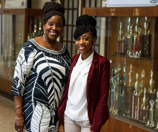 Lanier High School student Jasmine Jackson, right, who was given a scholarship to Alabama State University, is shown with her mother Amy Perry at the Lanier campus in Montgomery, Ala., on Thursday March 12, 2020.
