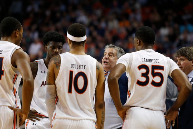 Auburn coach head coach Bruce Pearl talks to his players during a game against Tennessee at Auburn Arena on Feb. 22, 2020.
