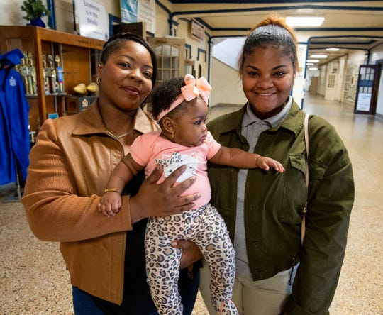 Lanier High School student Altoria Butler, right, who was given a scholarship to Alabama State University, is shown with her mother Algenae Dixon-Butler and her sister Alzariah Dixon at the Lanier campus in Montgomery, Ala., on Thursday March 12, 2020.