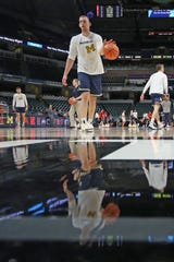 Mar 12, 2020; Indianapolis, Indiana, USA; The Michigan Wolverines warm up before the game against the Rutgers Scarlet Knights is cancelled with no fans in attendance due to Coronavirus prevention as the 2020 Big Ten Tournament has been cancelled at Bankers Life Fieldhouse. Mandatory Credit: Brian Spurlock-USA TODAY Sports
