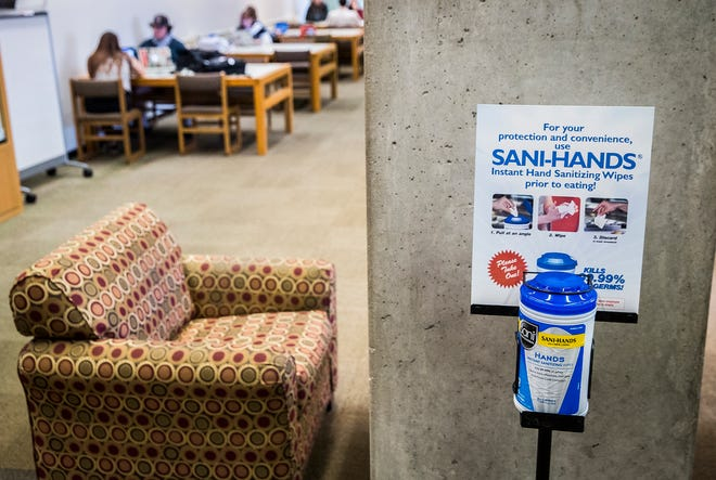 A hand sanitizing station inside Ball State's Bracken Library.