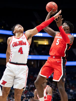 Georgia's Anthony Edwards (5) attempts a shot over Ole Miss guard Breein Tyree (4) during a basketball game between the Georgia Bulldogs and the Ole Miss Rebels during the SEC Basketball Tournament held at Bridgestone Arena in Nashville, Tenn., on Wednesday, March 11, 2020.