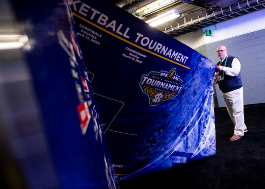 The tournament bracket is taken down off a hallway wall inside Bridgestone Arena after the Southeastern Conference decided to cancel the SEC Basketball Tournament over coronavirus concerns on Thursday, March 12, 2020.