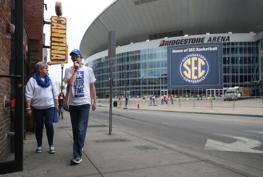 Kentucky fans walk across the street from Bridgestone Arena on Thursday morning.