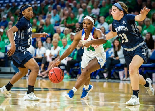 FGCU's Ashli O'Neal drives through North Florida defenders during the ASUN semifinal game Wednesday night at Alico Arena.