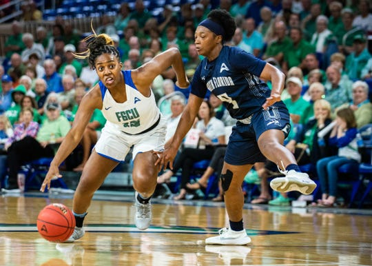FGCU's Tyra Cox drives by a North Florida defender during an ASUN semifinal Thursday at Alico Arena.
