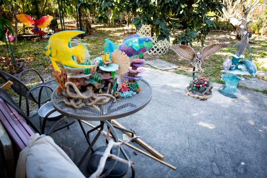 Various sculptures by Gilbert Sanchez decorate the backyard at his home in Golden Gate on Thursday, March 12, 2020.