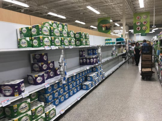 An aisle of toilet paper at the Publix in Bonita Springs, near the intersection of U.S. 41 and Bonita Beach Road, sits partially empty on March 12, 2020.