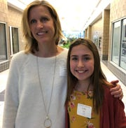 Heath Stevenson Elementary third grade teacher Angie Hile with her nominator for the You Made A Difference award, Lilly Mills, on Wednesday at C-TEC.