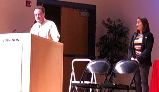 Newark Catholic Latin teacher Bob Smith accepts his You Made A Difference award Wednesday at C-TEC, as his nominator Livia Barnett watches.
