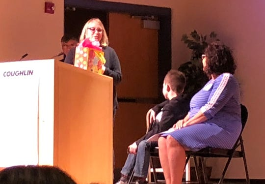 During her acceptance of the You Made A Difference Award at C-TEC Wednesday, Kirkersville Elementary first grade teacher Carolyn McDowell addresses nominator Van Fellows and his mother, Tina.