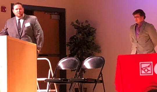 Northridge teacher and football coach Jay Campbell speaks at the You Made a Difference awards Wednesday at C-TEC, as his nominator Robert Halfhill looks on.