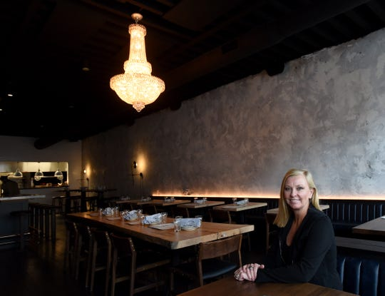 Denise Blankemyer, co-owner of Ghostwriter Public House and Crow Works, in downtown Johnstown. The manufacturing brand for custom furniture moved its corporate offices from Columbus to the renovated building in Johnstown last year. The furniture company has its offices above the restaurant.