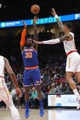 Mar 11, 2020; Atlanta, Georgia, USA; New York Knicks forward Julius Randle (30) shoots against Atlanta Hawks forward John Collins (20) in the second quarter at State Farm Arena.