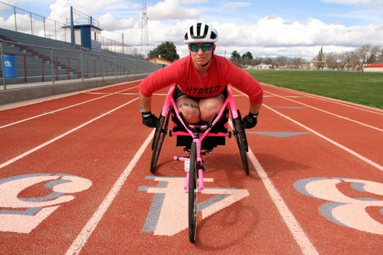 U.S. Army veteran Beth King is ready to roll during a recent workout. The 41-year-old combat soldier is preparing for military games in cycling, power-lifting, indoor rowing. track and field events and sprints and middle distance races.
