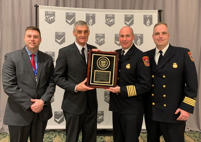 Left to right are, Joshua Meier, Canton Director of Public Safety; Steve Dongworth, CFAI Commission Chairperson; Chris Stoecklein, Canton Deputy Director of Fire; and Jamie Strassner, Canton Deputy Fire Chief