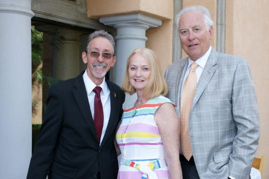 Doug Hassett, with event co-chairs Georgialee and Doug Lang.