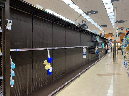 An aisle at a Palm Springs Ralphs is completely cleared of toilet paper amid the coronavirus outbreak on March 11, 2020.