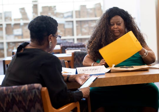 Franscine Mathis, a justice reform activist, meets with the Voncile Goldsmith at the M.C. Blanchard Judicial Center Library to review their plans before asking the State reopen the manslaughter conviction case of her son Rickie Goldsmith.